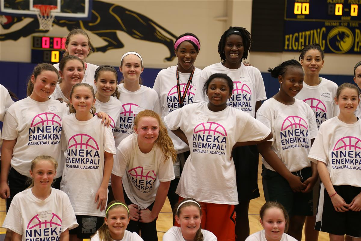 Nneka Enemkpali and basketball camp participants