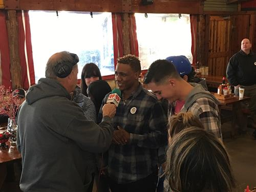 Students from PHS are interviewed by KVET 98.1 FM during the Coats For Kids Drive.