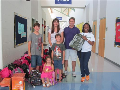 family from First Baptist Church donates 70 backpacks