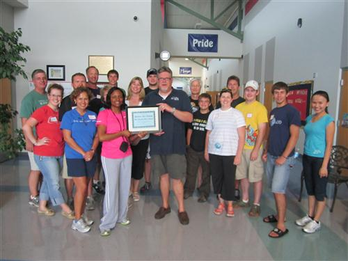 Hill Country Bible Church volunteers accepting plaque